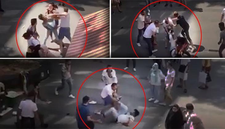 Antalya'nın en işlek caddesinde tekme tokatlı kavga! Yere düşürüp üstüne çullandılar