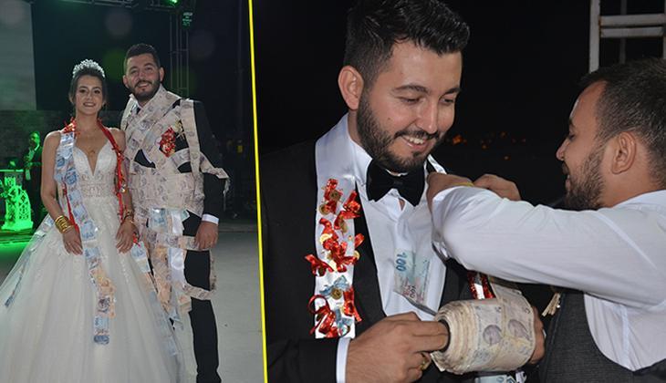 Düğünde damada arkadaşları tarafından 60 metre uzunluğunda 5 liralık banknotlar takıldı