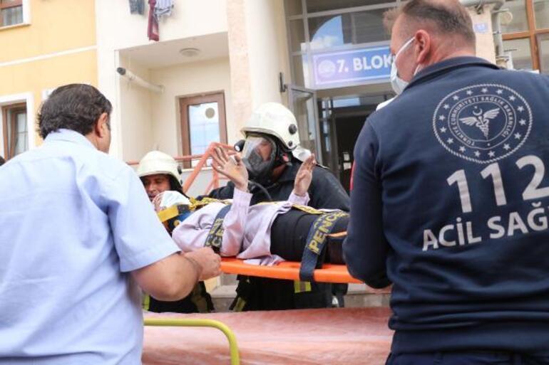 Alevlerden kurtulmak için önce kızını sonra kendisini aşağı attı